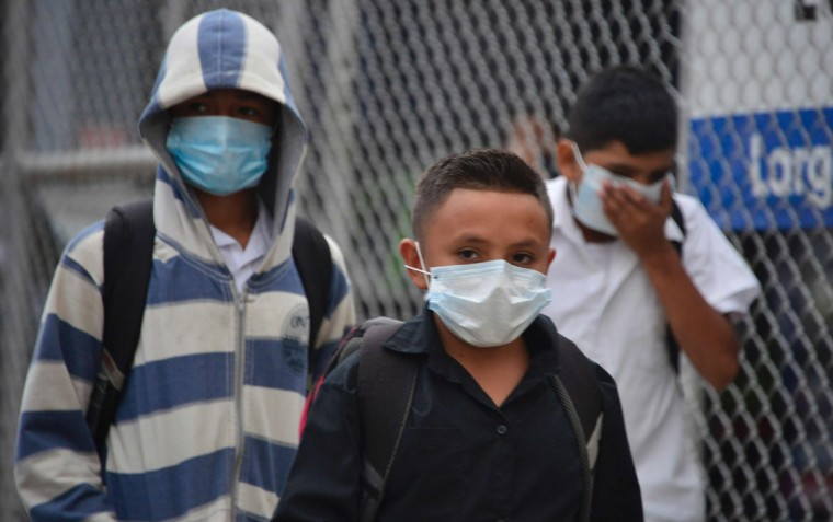 Local residents wear protective masks due to the ash spewed by the Turrialba volcano in Cartago, 35 Km east of San Jose, on September 19, 2016. The Costa Rican authorities suspended operations at the country's main airport Monday after the nearby Turrialba volcano erupted, sending a thick ash cloud into the sky. Turrialba erupted twice Monday, first at dawn and again just before noon. The second eruption sent an ash cloud 4,000 meters (13,000 feet) into the air. (EZEQUIEL BECERRA/AFP/Getty Images)