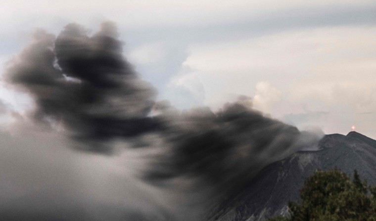 View of ash spewed by the Turrialba volcano in Cartago, 35 Km east of San Jose, on September 20, 2016. The Costa Rican authorities suspended operations at the country's main airport Monday after the nearby Turrialba volcano erupted, sending a thick ash cloud into the sky. Turrialba erupted twice Monday, first at dawn and again just before noon. The second eruption sent an ash cloud 4,000 meters (13,000 feet) into the air. (EZEQUIEL BECERRA/AFP/Getty Images)