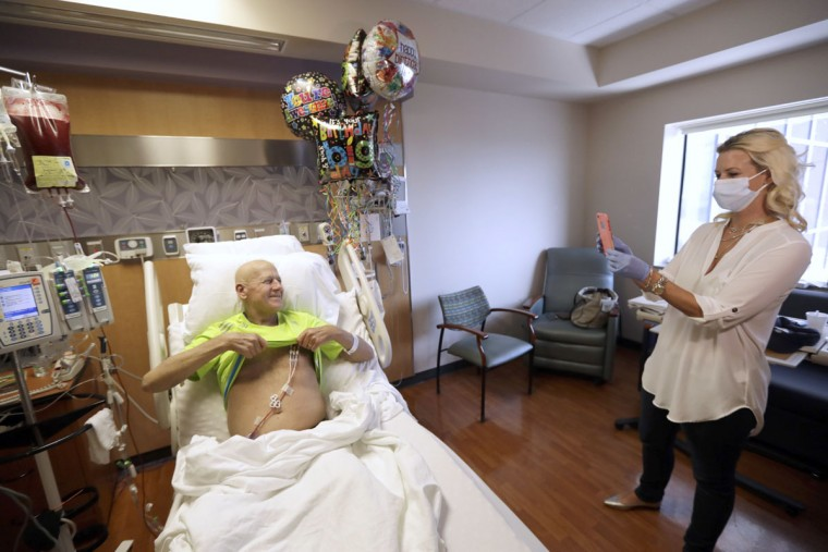 Sportscaster Craig Sager holds up his shirt as his wife Stacy takes a picture after starting his transplant procedure Wednesday, Aug. 31, 2016, at MD Anderson Hospital in Houston. Sager underwent his third bone marrow transplant as he continues to battle Acute myeloid leukemia. (AP Photo/David J. Phillip)