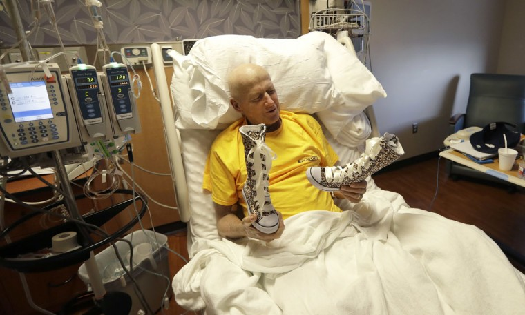 Sportscaster Craig Sager holds a pair of boots that once belonged to Lacey Holsworth while telling a story about their friendship Tuesday, Aug. 30, 2016, at MD Anderson Hospital in Houston. Holsworth died of cancer in 2014. Sager underwent his third bone marrow transplant Wednesday as he continues to battle acute myeloid leukemia. (AP Photo/David J. Phillip)