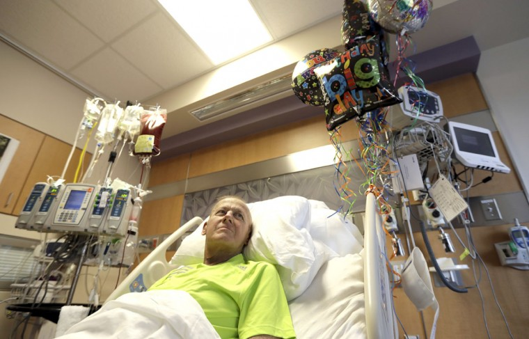 Sportscaster Craig Sager lies in his bed while receiving a transplant Wednesday, Aug. 31, 2016, at MD Anderson Hospital in Houston. Sager underwent his third bone marrow transplant as he continues to battle Acute myeloid leukemia. (AP Photo/David J. Phillip)