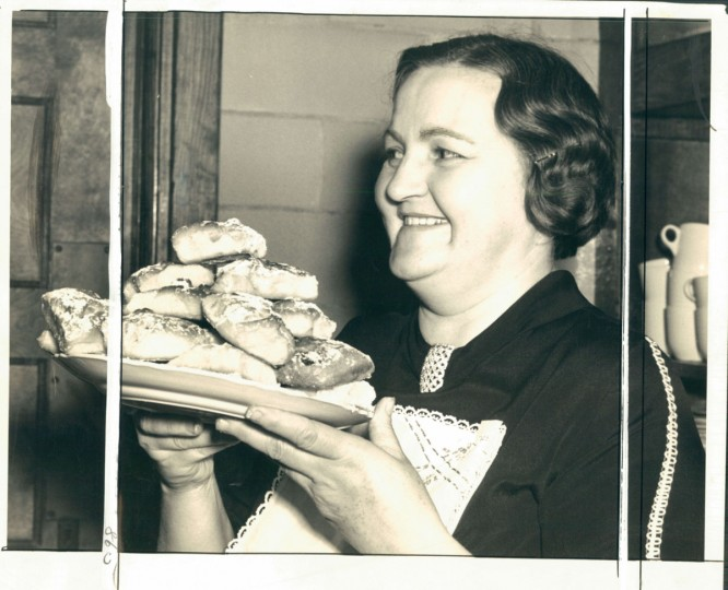 "Undated photo of Baltimore woman holding kolaschky - a ""native Bohemian dish."" according to the caption. (Baltimore Sun Archives)"