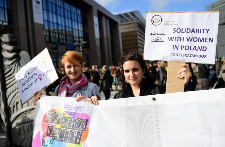 People protest against a proposed near-total abortion ban in Poland in front of European institutions in Brussels, on October 3, 2016. (Emmanuel Dunand/AFP/Getty Images)
