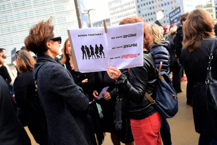 Protesters gather outside the European institutions in Brussels to demonstrate against a proposed parliament bill in Poland to completely ban abortion on October 3, 2016. The bill proposes near-total abortion ban in the devoutly Catholic country, where the law is already among the most restrictive in Europe. (Emmanuel Dunand/AFP/Getty Images)