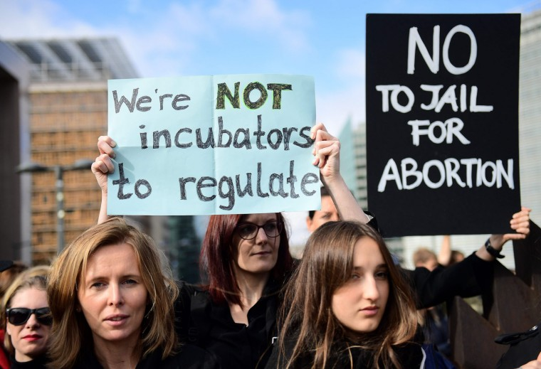 People protest against a proposed near-total abortion ban in Poland front of European institutions in Brussels, on October 3, 2016. (Emmanuel Dunand/AFP/Getty Images)