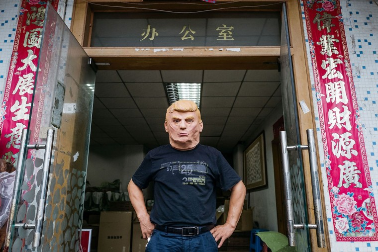 SHENZHEN, CHINA - OCTOBER 18: An employee wearing a mask of Donald Trump poses for a photograph at the Shenzhen Lanbingcai Latex Crafts Factory on October 18, 2016 in Shenzhen, China. Shenzhen Lanbingcai Latex Crafts Factory, located in the industrial area of Shenzhen with 20 to 30 employees, produces all sort of Halloween and party costumes and masks. It runs a small scale production of Donald Trump masks for local distribution within mainland China costing from 30 Renminbi onwards as the third Presidential Debate 2016 between Donald Trump and Hillary Clinton happens on Thursday. Chinese media have derided the election as a risible variety show in which the candidates' spectacular personal failings have taken precedence over the business of governance. (Photo by Anthony Kwan/Getty Images)