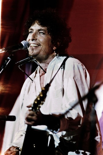 FILE - This file photo taken on July 13, 1985 shows US singer Bob Dylan performing on the stage of the John F Kennedy Stadium in Philadelphia during the first international live aid concert against hunger in Africa. US songwriter Bob Dylan won the Nobel Literature Prize on October 13, 2016, the first songwriter to win the prestigious award and an announcement that surprised prize watchers. (Micelotta Frank/AFP/Getty Images)