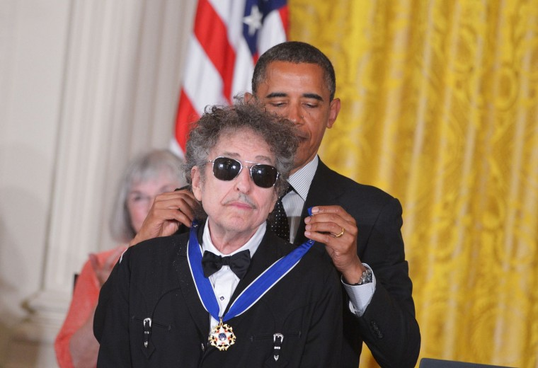 FILE - This file photo taken on May 29, 2012 shows US President Barack Obama (R) presenting the Presidential Medal of Freedom to US musician Bob Dylan in the East Room of the White House in Washington. US songwriter Bob Dylan won the Nobel Literature Prize on October 13, 2016, the first songwriter to win the prestigious award and an announcement that surprised prize watchers. (Mandel Ngan/AFP/Getty Images)