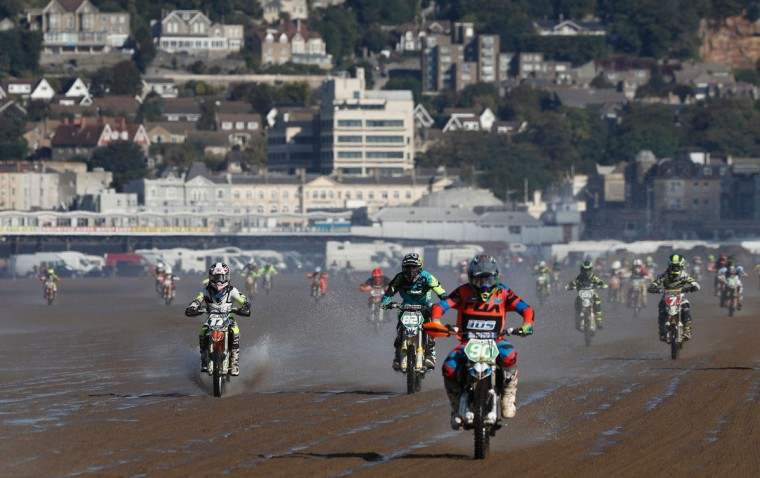 Junior riders race down the beach during the Youth 85BW/85SW Race at the 2016 HydroGarden Weston Beach Race in Weston-super-Mare, south west England, on October 9, 2016. Beach racing is an offshoot of enduro and motocross racing. Riders on solo motorcycles and quad bikes compete on a course marked out on a beach, with man-made jumps and sand dunes being constructed to make the course tougher. (ADRIAN DENNIS/AFP/Getty Images)
