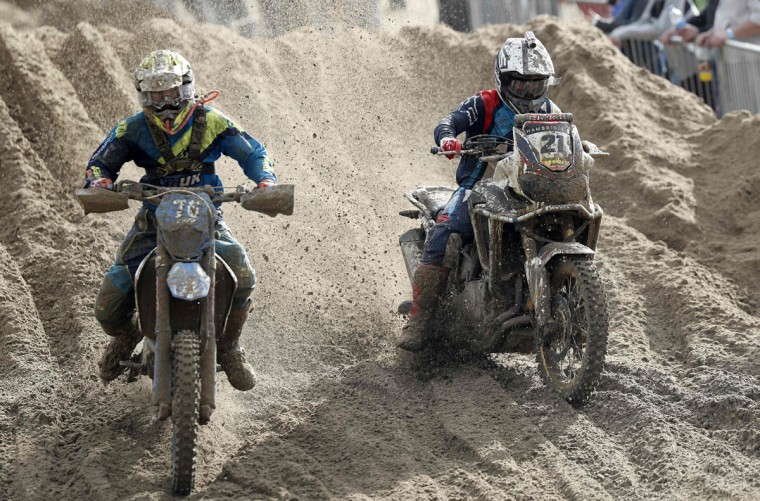Former World Motocross Champion Dave Thorpe (right) rides a Honda Africa Twin motorcycle as he competes in the Adult Solo race at the HydroGarden Weston Beach Race in Weston-super-Mare, south west England, on October 9, 2016. Beach racing is an offshoot of enduro and motocross racing. Riders on solo motorcycles and quad bikes compete on a course marked out on a beach, with man-made jumps and sand dunes being constructed to make the course tougher. (ADRIAN DENNIS/AFP/Getty Images)