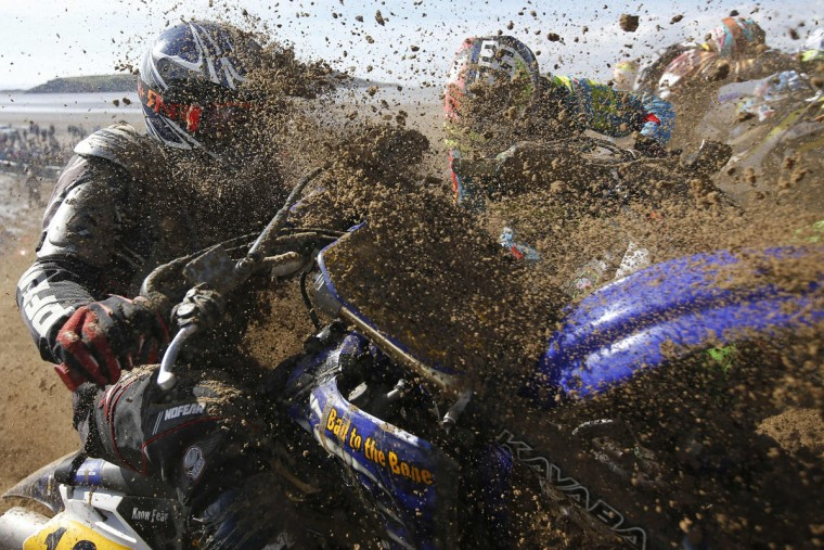 Riders negotiate a dune as they compete in the Adult Solo race at the HydroGarden Weston Beach Race in Weston-super-Mare, south west England, on October 9, 2016. Beach racing is an offshoot of enduro and motocross racing. Riders on solo motorcycles and quad bikes compete on a course marked out on a beach, with man-made jumps and sand dunes being constructed to make the course tougher. (ADRIAN DENNIS/AFP/Getty Images)