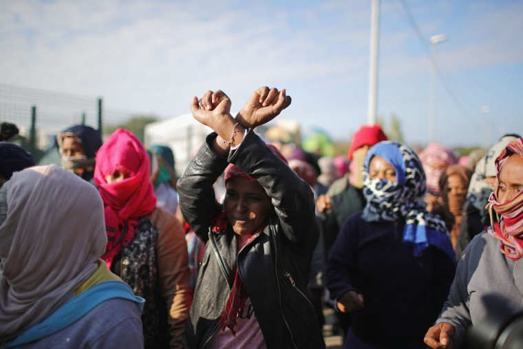 "Women take part in a protest calling on the UK government to help migrants of the ""Jungle"" camp before authorities demolish the site on October 25, 2016 in Calais, France. Many migrants have left by coach to be reloctated at centres across France as Police and officials in France begin to clear the 'Jungle' migrant camp in Calais. Some 7,000 people are estimated to be living in the camp in squalid conditions. (Photo by Christopher Furlong/Getty Images)"