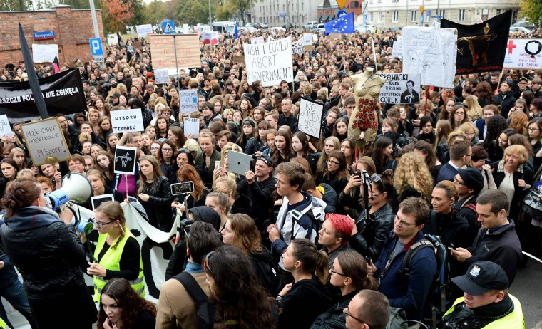 "People take part in a nationwide strike and demonstration to protest against a legislative proposal for a total ban of abortion on October 3, 2016 in Warsaw. Thousands of women dressed in black protested across Poland in the ""Women strike"" campaign against a proposed near-total abortion ban in the devoutly Catholic country where legislation is already among the most restrictive in Europe. (Janek Skarzynski/AFP/Getty Images)"