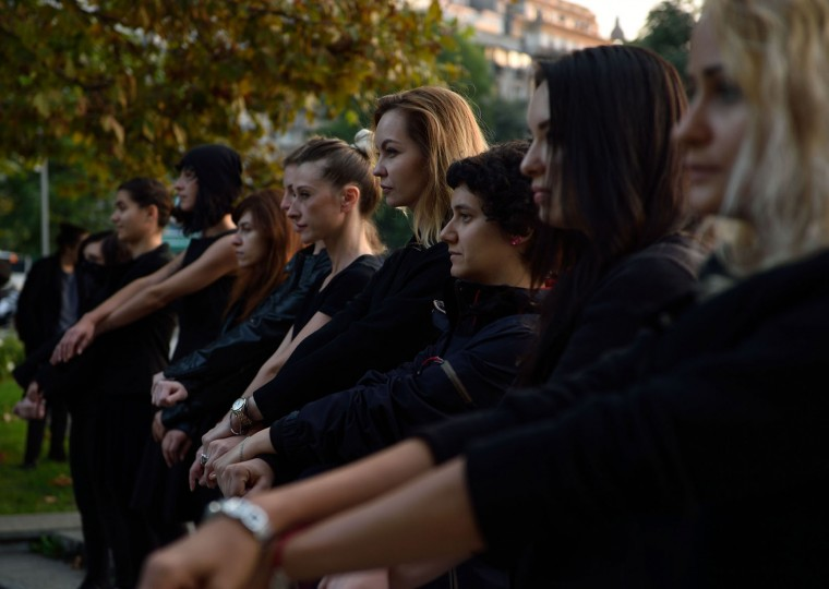 "Romanian women show support with Polish women on strike during a flashmob in Piata Universitatii square in Bucharest on October 3, 2016. Thousands of women dressed in black protested across Poland in the ""Women strike"" campaign against a proposed near-total abortion ban in the devoutly Catholic country where legislation is already among the most restrictive in Europe. (Daniel Mihailescu/AFP/Getty Images)"