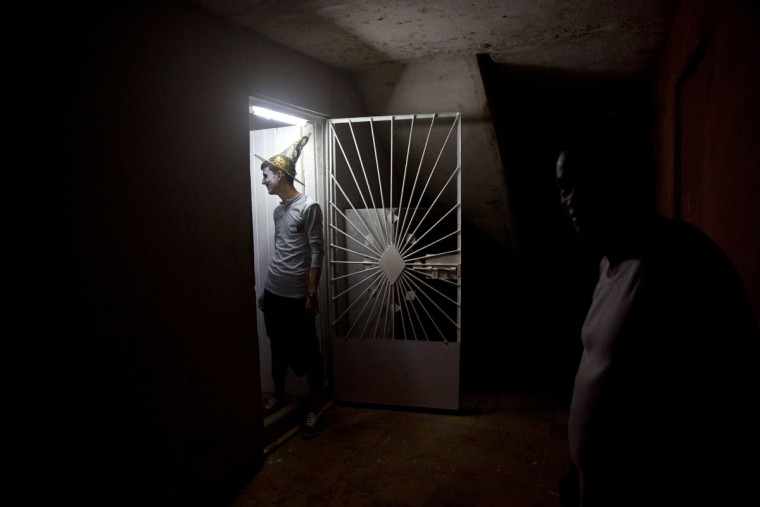 A young man in costume arrives for a Halloween party at a residence in Havana, Cuba, late Friday, Oct. 28, 2016. Inspired by pirated U.S. movies and television shows, young Cubans are turning American-style Halloween parties into the island's latest trend. (AP Photo/Ramon Espinosa)