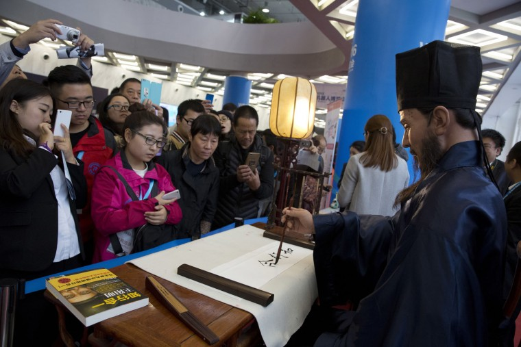 A robot writes calligraphy at the World Robot Conference in Beijing, China, Friday, Oct. 21, 2016. The conference showcased China's burgeoning robot industry as the nation seeks to increase the use of robots in its manufacturing and service industries. (AP Photo/Ng Han Guan)