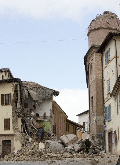 A view of the collapsed bell tower of the Santa Maria in Via church in the town of Camerino, in central Italy, Thursday, Oct 27, 2016, after a 5.9 earthquake destroyed part of the town. Authorities began early Thursday to assess the damage caused by a pair of strong quakes in the same region of central Italy hit by the deadly August temblor, as local officials appealed for temporary housing adequate for the cold mountain temperatures with winter's approach. (AP Photo/Alessandra Tarantino)