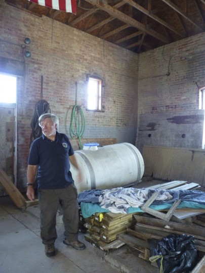 In this photo taken Monday, Sept. 12, 2016, Marv Kuziel of the Port Austin Reef Light Association stands in the steam room that once powered the Port Austin Reef Lighthouse more than two miles off the Michigan shore in Lake Huron's Saginaw Bay. Members of the nonprofit association have worked for decades to restore the structure, which was last inhabited by light keepers in 1952. (AP Photo/Roger Schneider)