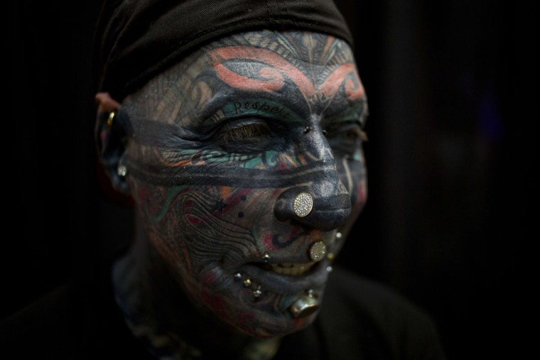Magneto of Berlin Germany poses for a photograph during the Israel Tattoo Convention in Tel Aviv, Israel, Friday, Oct. 7, 2016. Around 140 tattoo artists from Israel and other countries participated in a 2 day fair in Tel Aviv. (AP Photo/Ariel Schalit)