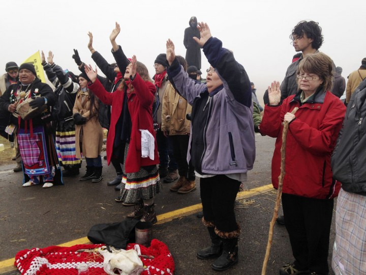 Protesters against the construction of the Dakota Access oil pipeline block a highway in near Cannon Ball, N.D., on Wednesday, Oct. 26, 2016. Law enforcement officials have asked people protesting the Dakota Access oil pipeline to vacate an encampment on private land, and the protesters said no. Protesters are trying to halt construction of the pipeline they fear will harm cultural sites and drinking water for the Standing Rock Sioux. (AP Photo/James MacPherson)
