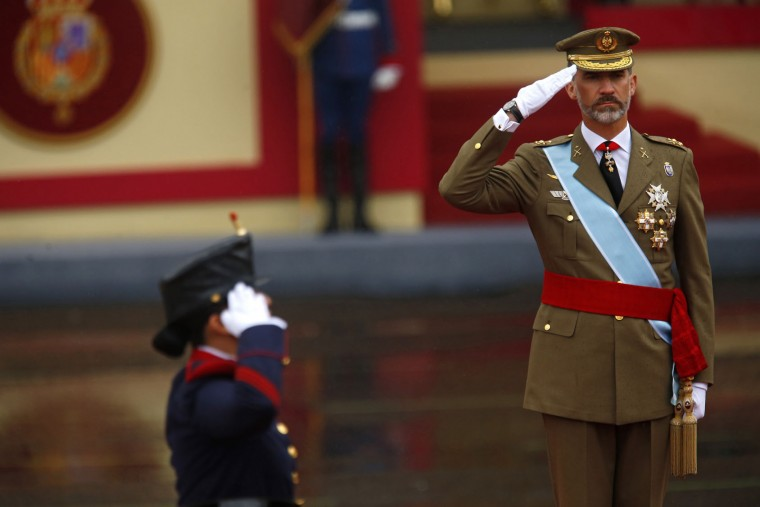 """Spain's King Felipe salutes during a military parade celebrating a national holiday known as """"Dia de la Hispanidad"""" or Hispanic Day, in Madrid, Spain, Wednesday, Oct. 12, 2016. Almost a year into Spain's political deadlock, the country is celebrating its National Day with a military parade of over 3,000 soldiers marching through Madrid and aircraft drawing trails of red and yellow smoke in the sky to represent the flag. (AP Photo/Francisco Seco)"""