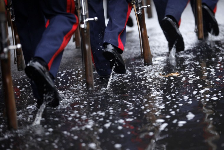 """Spanish soldiers march in the rain in a military parade during a national holiday known as """"Dia de la Hispanidad"""" or Hispanic Day, in Madrid, Spain, Wednesday, Oct. 12, 2016. Almost a year into Spain's political deadlock, the country is celebrating its National Day with a military parade of over 3,000 soldiers marching through Madrid and aircraft drawing trails of red and yellow smoke in the sky to represent the flag. (AP Photo/Francisco Seco)"""