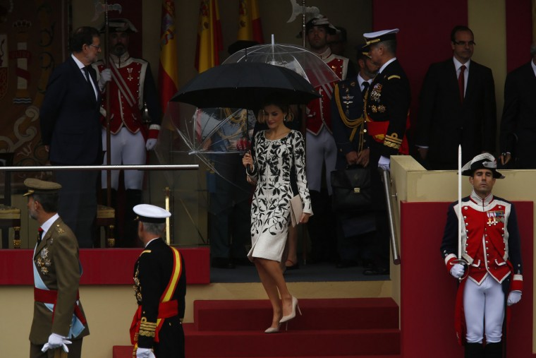 """Spain's Queen Letizia, centre, leaves the stage at the end of a military parade during a national holiday known as """"Dia de la Hispanidad"""" or Hispanic Day, in Madrid, Spain, Wednesday, Oct. 12, 2016. Almost a year into Spain's political deadlock, the country is celebrating its National Day with a military parade of over 3,000 soldiers marching through Madrid and aircraft drawing trails of red and yellow smoke in the sky to represent the flag. (AP Photo/Francisco Seco)"""