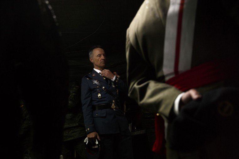 A member of the Spanish air Force adjusts his tie before a military parade as they celebrate a holiday known as 'Dia de la Hispanidad' or Hispanic Day in Madrid, Wednesday, Oct. 12, 2016. Almost a year into Spain's political deadlock, the country is celebrating its National Day with a military parade of over 3,000 soldiers marching through Madrid and aircraft drawing trails of red and yellow smoke in the sky to represent the flag. (AP Photo/Daniel Ochoa de Olza)
