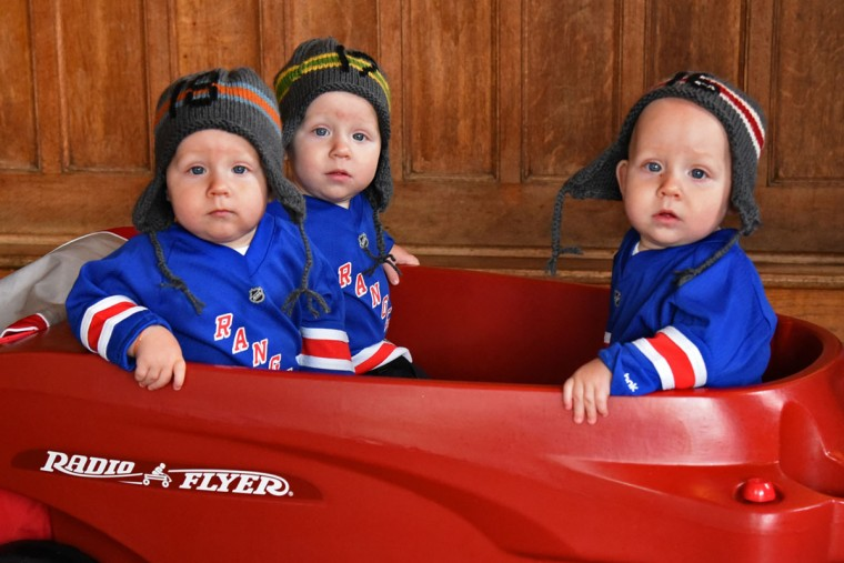 From left, Ollie, Finn and Trip arrived at their birthday party at Cafe Hon in a three-seat wagon. (Amy Davis/ Baltimore Sun)