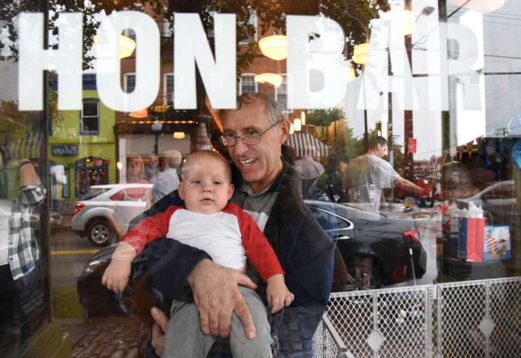 Maternal grandfather Jim Stantz holds Trip as they look out the window from Cafe Hon during the birthday party for the triplets. The identical Hewitt triplets turned one on Oct. 6. (Amy Davis/ Baltimore Sun)