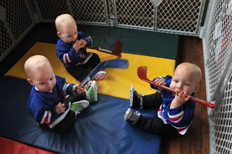 The birthday boys, from left, Finn, Trip and Ollie Hewitt, were dressed in New York Rangers gear for their first birthday party, thrown by parents Thomas and Kristen Hewitt at Cafe Hon. They still think hockey sticks are something to chew on. The identical triplets turned one on Oct. 6. (Amy Davis/ Baltimore Sun)