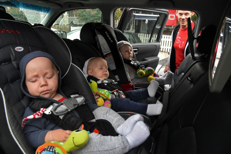 Thomas Hewitt looks in on his sons after he drove around with them for one hour so that they would be rested for their birthday party. The identical triplets, from left, Trip, Finn and Ollie, turned one on Oct. 6. (Amy Davis/ Baltimore Sun)