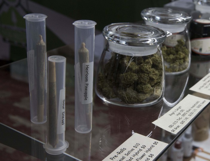 In this Thursday, Oct. 13, 2016 photo, marijuana products, including pre-rolled cigarettes and buds are displayed at the medical marijuana dispensary owned by Tim Blake near Laytonville, Calif. Blake supports the passage of Proposition 64, the November ballot initiative which would legalize the recreational use of marijuana, saying it's the next big step for an industry emerging from the shadows. (AP Photo/Rich Pedroncelli)