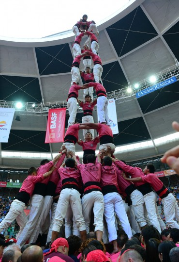 "Members of the Chinese ""Xiquets de Hangzhou"" human tower team form a ""castell"" during the XXVI human towers, or castells, competetion in Tarragona on October 1, 2016. These human towers, built traditionally in festivals within Catalonia, gather several teams that attempt to build and dismantle a tower structure. (LLUIS GENE/AFP/Getty Images)"