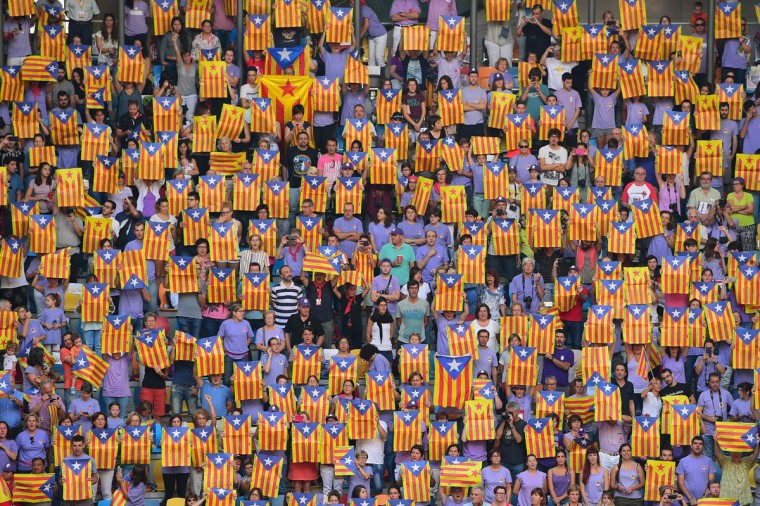 People show 'Esteladas' (pro-independence Catalan flags) as they gather during the XXVI human towers, or 'castells', competetion in Tarragona on October 2, 2016. These human towers, built traditionally in festivals within Catalonia, gather several teams that attempt to build and dismantle a human tower structure. (LLUIS GENE/AFP/Getty Images)