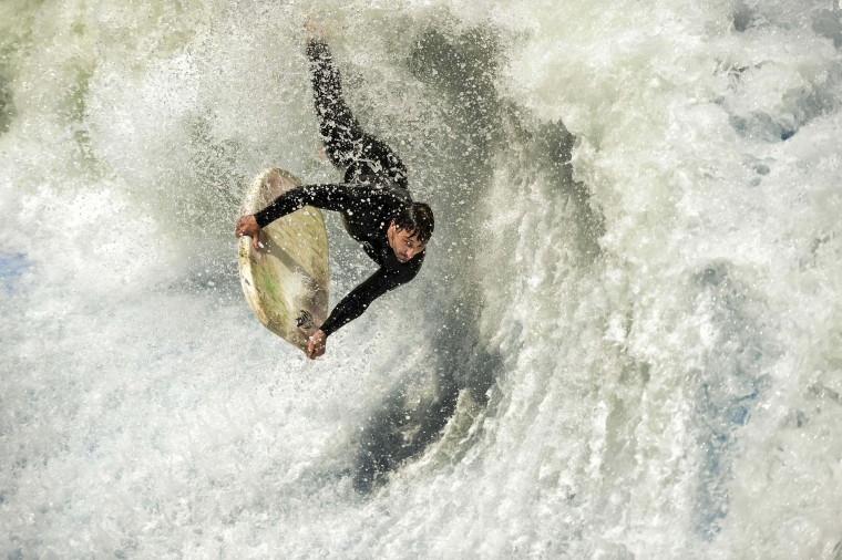 A flowrider competes on an artificial wave, during the Flow Tour 2016 in Santiago on October 22, 2016. Artificial waves are created by powerful pumps that throw thousands of liters of water against a wall. The size of the wave can be regulated to suit the skills of the surfer and can reach a height up to three meters. (MARTIN BERNETTI/AFP/Getty Images)