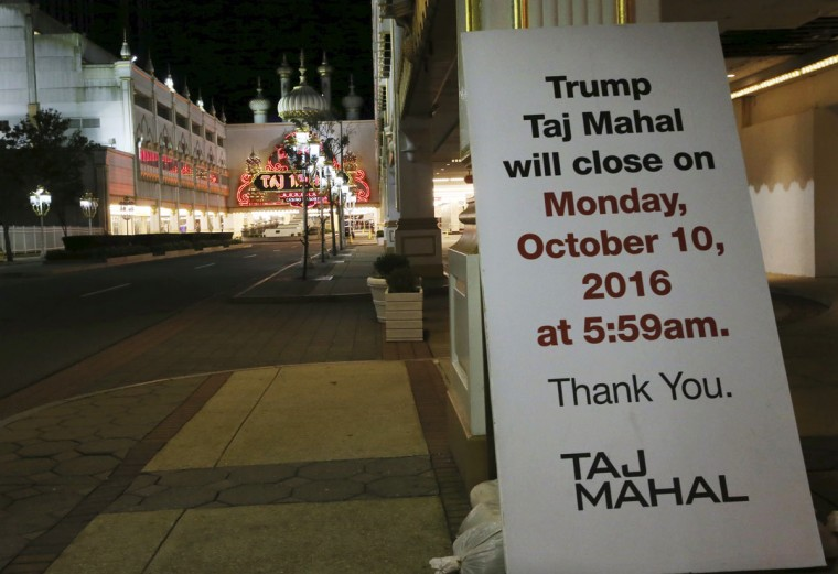 A sign outside the Trump Taj Mahal announces the property's closing, early Monday, Oct. 10, 2016, in Atlantic City, N.J. The sprawling Boardwalk casino, with its soaring domes, minarets and towers built to mimic the famed Indian palace, shut down at 5:59 a.m., having failed to reach a deal with its union workers to restore health care and pension benefits that were taken away from them in bankruptcy court. (AP Photo/Mel Evans)