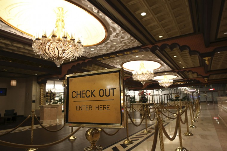 A sign is seen in the empty lobby at the closing Trump Taj Mahal early Monday, Oct. 10, 2016, in Atlantic City, N.J. The sprawling Boardwalk casino, with its soaring domes, minarets and towers built to mimic the famed Indian palace, shut down at 5:59 a.m., Monday, Oct. 10, 2016, having failed to reach a deal with its union workers to restore health care and pension benefits that were taken away from them in bankruptcy court. (AP Photo/Mel Evans)