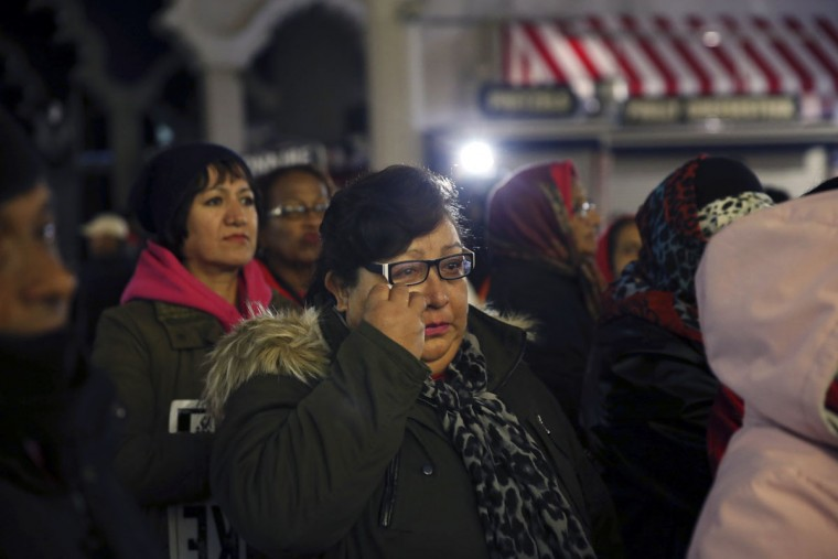 A woman wipes tears as she stands with others outside the closing Trump Taj Mahal, Monday, Oct. 10, 2016, in Atlantic City, N.J. The sprawling Boardwalk casino, with its soaring domes, minarets and towers built to mimic the famed Indian palace, shut down at 5:59 a.m., having failed to reach a deal with its union workers to restore health care and pension benefits that were taken away from them in bankruptcy court. (AP Photo/Mel Evans)