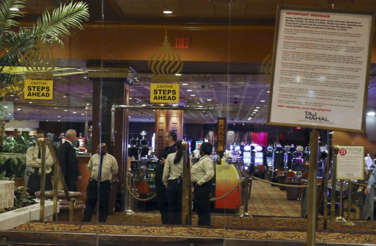 A security guards gather inside the Trump Taj Mahal early Monday, Oct. 10, 2016, in Atlantic City, N.J. The sprawling Boardwalk casino, with its soaring domes, minarets and towers built to mimic the famed Indian palace, shut down at 5:59 a.m., Monday, Oct. 10, 2016, having failed to reach a deal with its union workers to restore health care and pension benefits that were taken away from them in bankruptcy court. (AP Photo/Mel Evans)