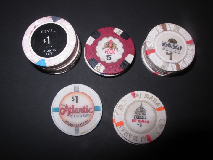 This Tuesday, Oct. 4, 2016 photo, shows gambling chips from the five Atlantic City casinos that will have gone out of business as of Oct. 10, 2016, when the Trump Taj Mahal shuts its doors. Clockwise from top left, the chips are from Revel, Trump Plaza, the Showboat, the Trump Taj Mahal, and The Atlantic Club. (AP Photo/Wayne Parry)