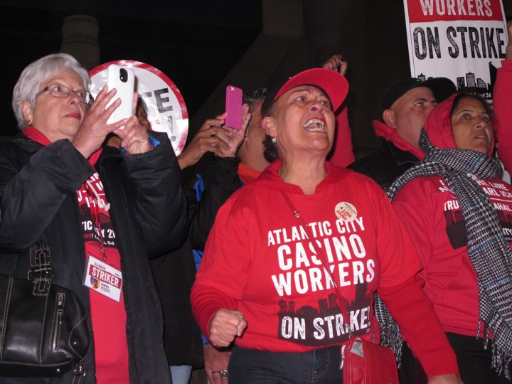 In this Oct. 10, 2016 photo, striking union members chant slogans outside the Trump Taj Mahal casino in Atlantic City N.J., as it closed. The casino that was opened by Republican presidential nominee Donald Trump, but is now owned by Carl Icahn, was the fifth Atlantic City casino to go out of business since 2014. A bill making its way through the New Jersey legislature would prevent Icahn from retaining the Taj Mahal's casino license now that it is closed. (AP Photo/Wayne Parry)