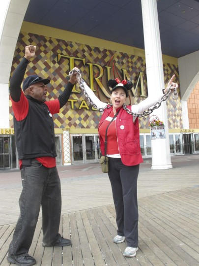 In this Wednesday, Oct. 5, 2016 photo, striking casino workers Chuck Baker, left, and Tina Condos, right, demonstrate outside the Trump Taj Mahal casino in Atlantic City N.J., where both have worked since the day it opened in 1990. The casino is to close at 6 a.m. Monday Oct. 10, 2016, the fifth Atlantic City casino to go out of business since 2014. (AP Photo/Wayne Parry)