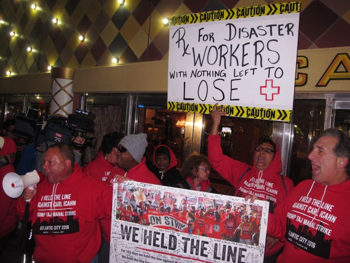 Striking casino workers chant outside the Trump Taj Mahal casino in Atlantic City, N.J., as it shuts down on Monday, Oct. 10, 2016. The casino was opened by Republican presidential nominee Donald Trump but was most recently owned by fellow billionaire Carl Icahn. (AP Photo/Wayne Parry)