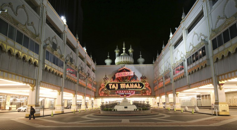 A person walks from the Trump Taj Mahal, early Monday, Oct. 10, 2016, in Atlantic City, N.J. The sprawling Boardwalk casino, with its soaring domes, minarets and towers built to mimic the famed Indian palace, shut down at 5:59 a.m., Monday, Oct. 10, 2016, having failed to reach a deal with its union workers to restore health care and pension benefits that were taken away from them in bankruptcy court. (AP Photo/Mel Evans)