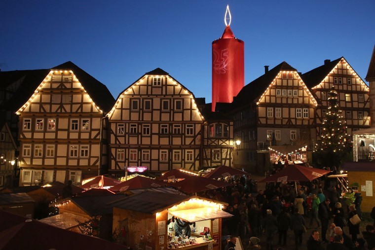 SCHLITZ, GERMANY - NOVEMBER 27: The effigy of a giant candle stands at the annual Christmas Market on November 26, 2016 in Schlitz, Germany. Christmas markets are opening across Germany this week in a tradition that dates back centuries. For the next four weeks the Christmas markets, which are usually located on the main square of the hosting town or village, will provide holiday cheer with mulled wine, sausages, Christmas ornaments and other delights. (Photo by Hannelore Foerster/Getty Images)