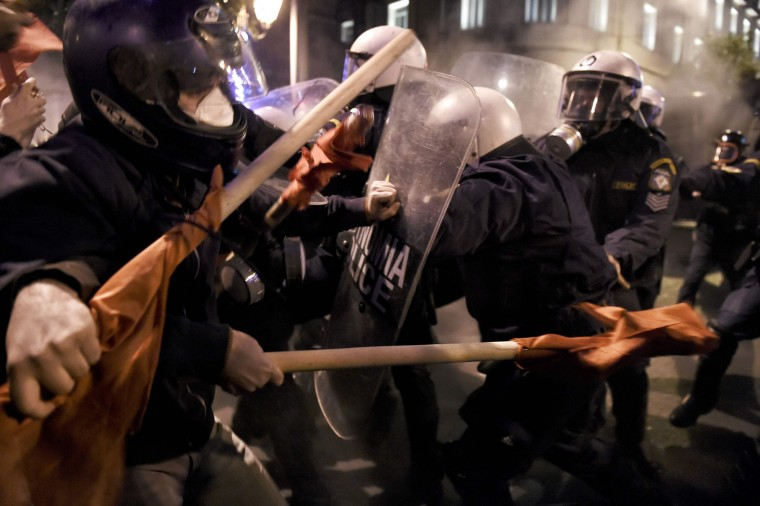Demonstrators clash with Greek riot police during a protest against the visit of the US president in Athens on November 15, 2016. US President Barack Obama is in Greece on a two-day official visit. (Aris Messinis/AFP/Getty Images)
