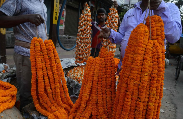 Indian vendors arrange marigold flowers at a roadside stall to be sold ahead of the forthcoming Chhath Puja Festival in Siliguri on on November 5,2016. The Chhath Festival is one of the most important festivals in the northern Indian states, and sees people worshiping the Sun god on the banks of rivers or small ponds, and praying for the longevity and health of their spouse. (Diptendu Dutta/AFP/Getty Images)