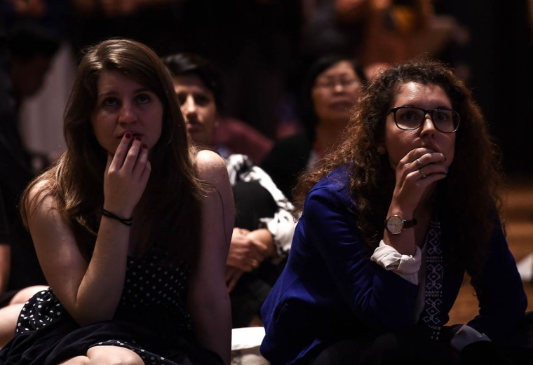 Women react as they watch a live-telecast of US Presidential election results during an event in Kuala Lumpur on November 9, 2016. Donald Trump has stunned America and the world, riding a wave of populist resentment to defeat Hillary Clinton in the race to become the 45th president of the United States. / AFP PHOTO / Manan Vatsyayana