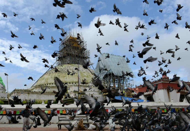 This photograph taken on August 29, 2015, shows the Boudhanath Stupa undergoing repairs, after it was damaged in an earthquake, on the outskirts of the Nepalese capital Kathmandu. Boudhanath Stupa has been reopened following renovation for earthquake damage. The stupa was among hundreds of historic monuments damaged during the 7.8-magnitude quake that hit Nepal in April 2015, killing nearly 9,000 people. (Prakash Mathema/AFP/Getty Images)